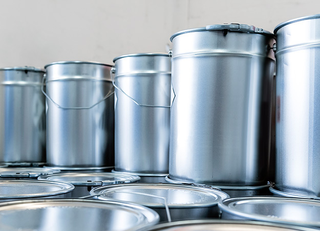 Silver buckets filled with fibasol liquid colorants