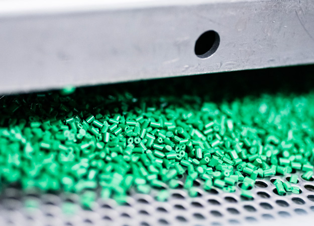 Green colored plastic components by fibaplast masterbatches